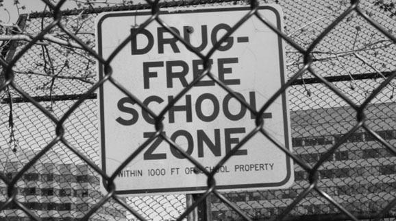 Possessing drugs in a school zone often triggers a mandatory minimum sentence.