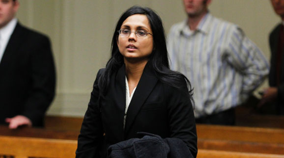 Annie Dookhan, a former chemist at a crime lab, listens to the judge during her arraignment in Brockton, Massachusetts, on Jan. 30, 2013.
